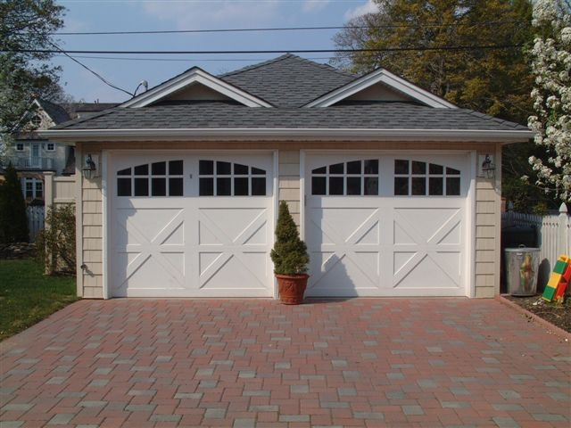 white semi-custom garage door with arched windows
